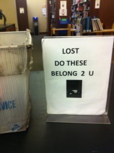 Photo of sign in Perkins Library for lost and found